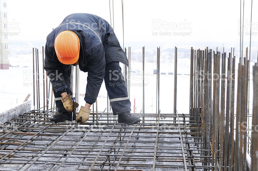 worker at construction site making carcass stock photo