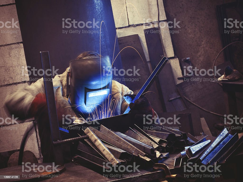 Worker at his workplace welding stock photo