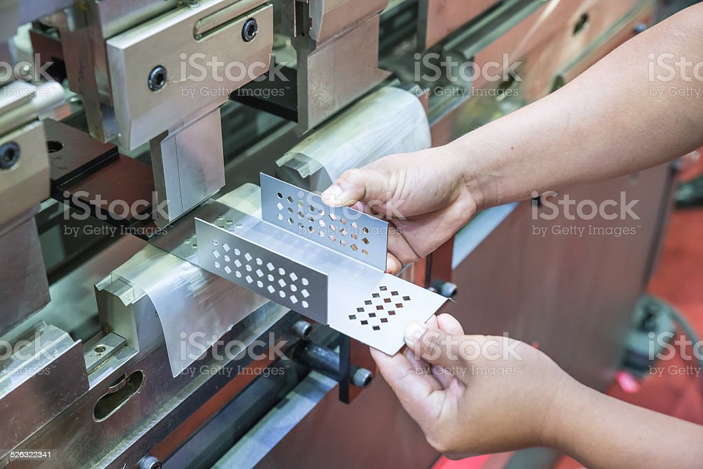 Worker at manufacture workshop operating cidan folding machine stock photo