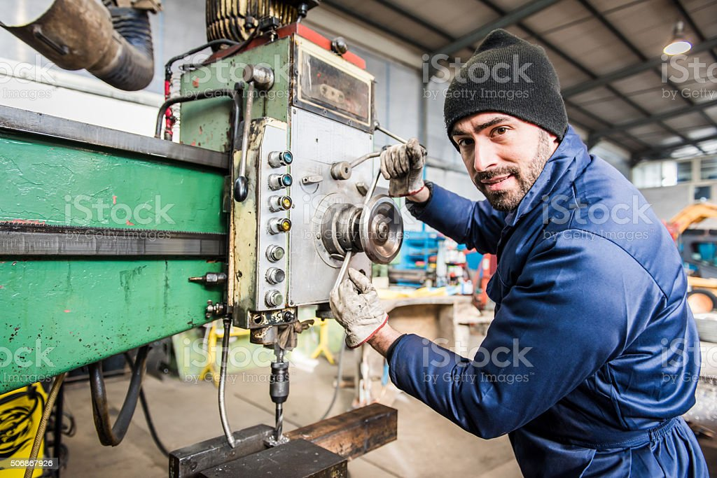 Worker at milling machine in workshop. stock photo