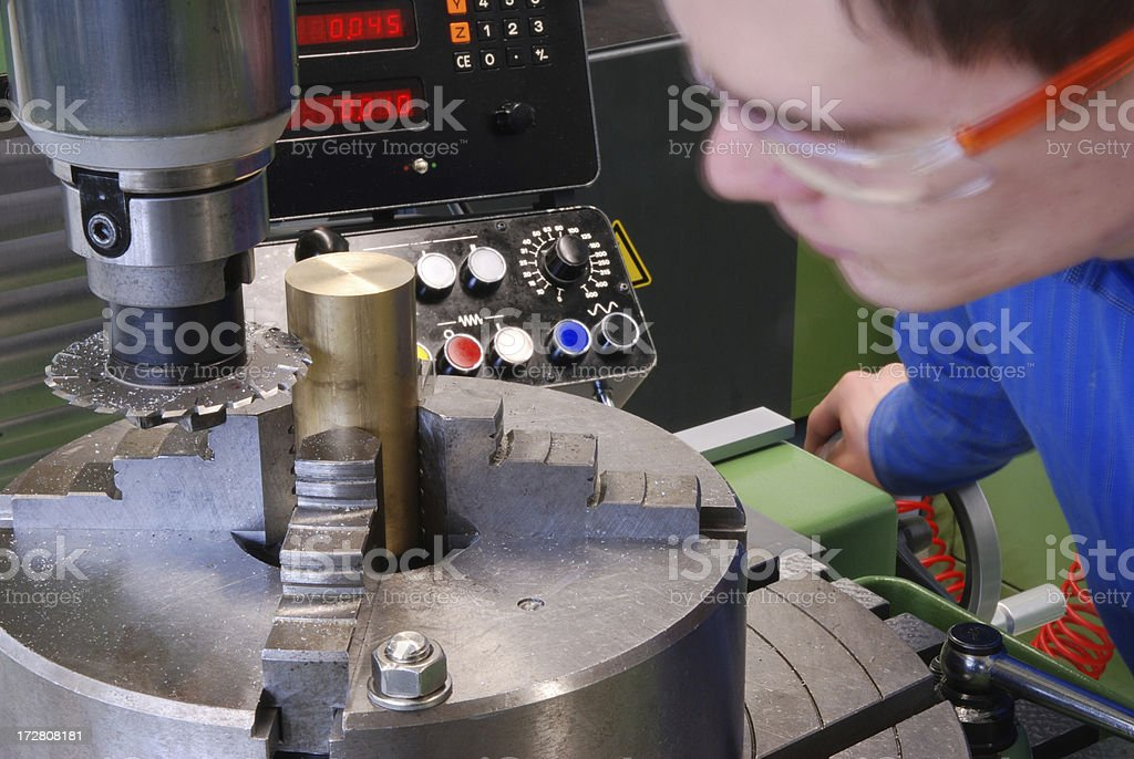 Worker at milling machine stock photo