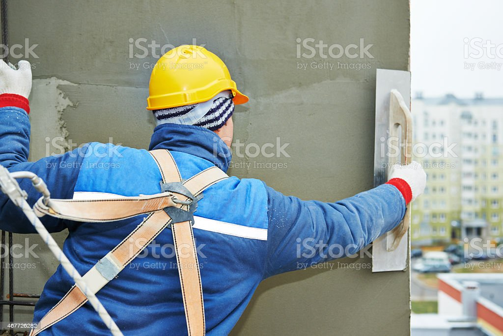 worker at plastering facade work stock photo