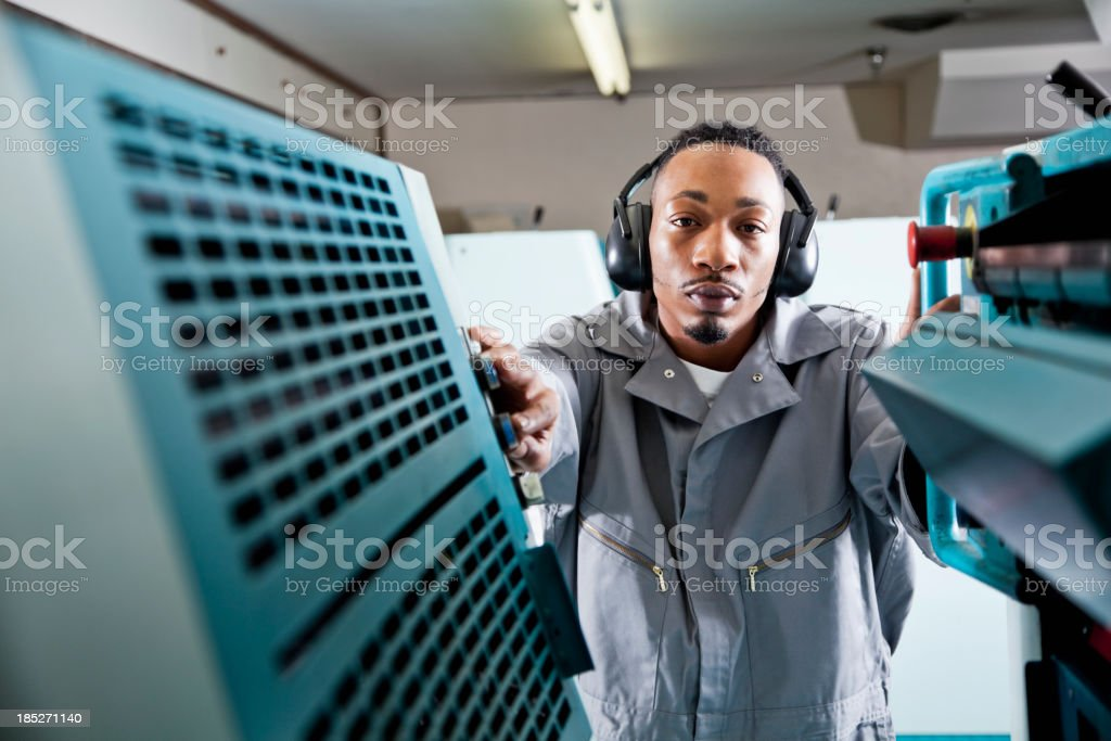 Worker at printing plant stock photo