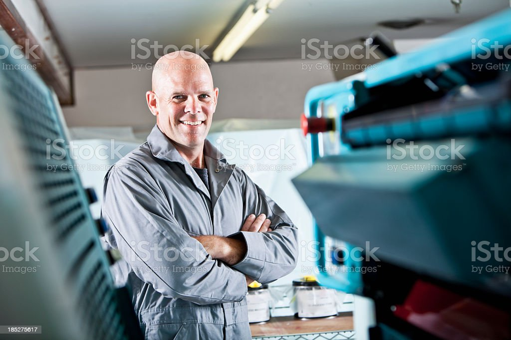 Worker at printing plant royalty-free stock photo