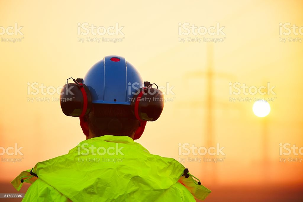 Worker at the sunrise stock photo