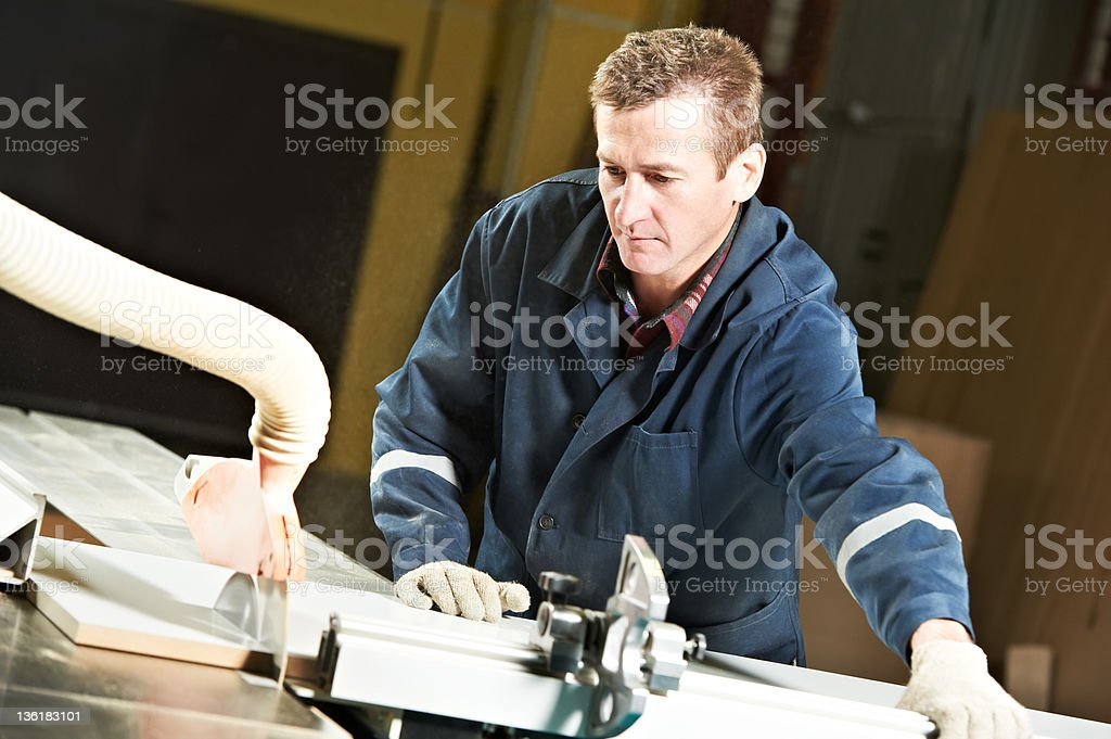 worker at workshop with circ saw royalty-free stock photo