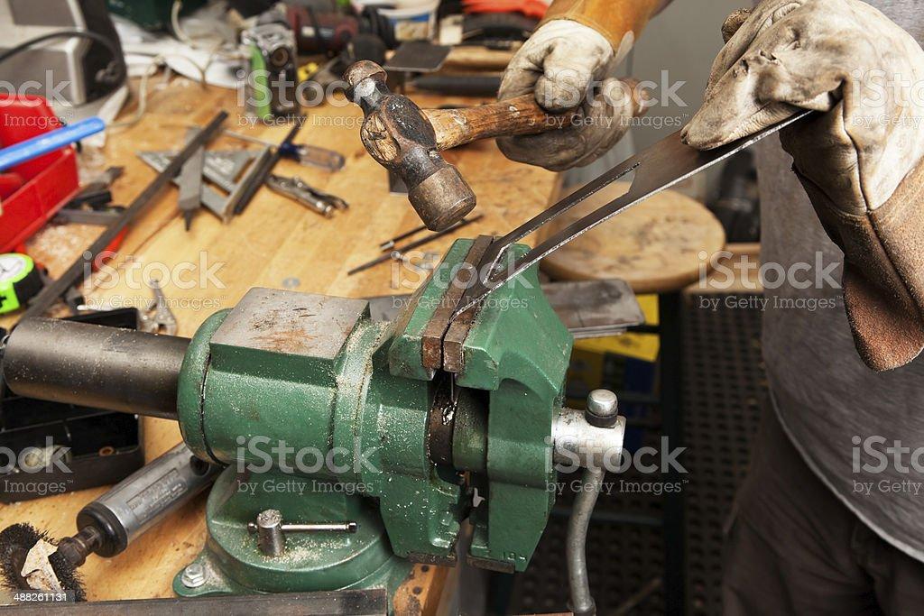 Worker Bending Metal with Ball Peen Hammer stock photo