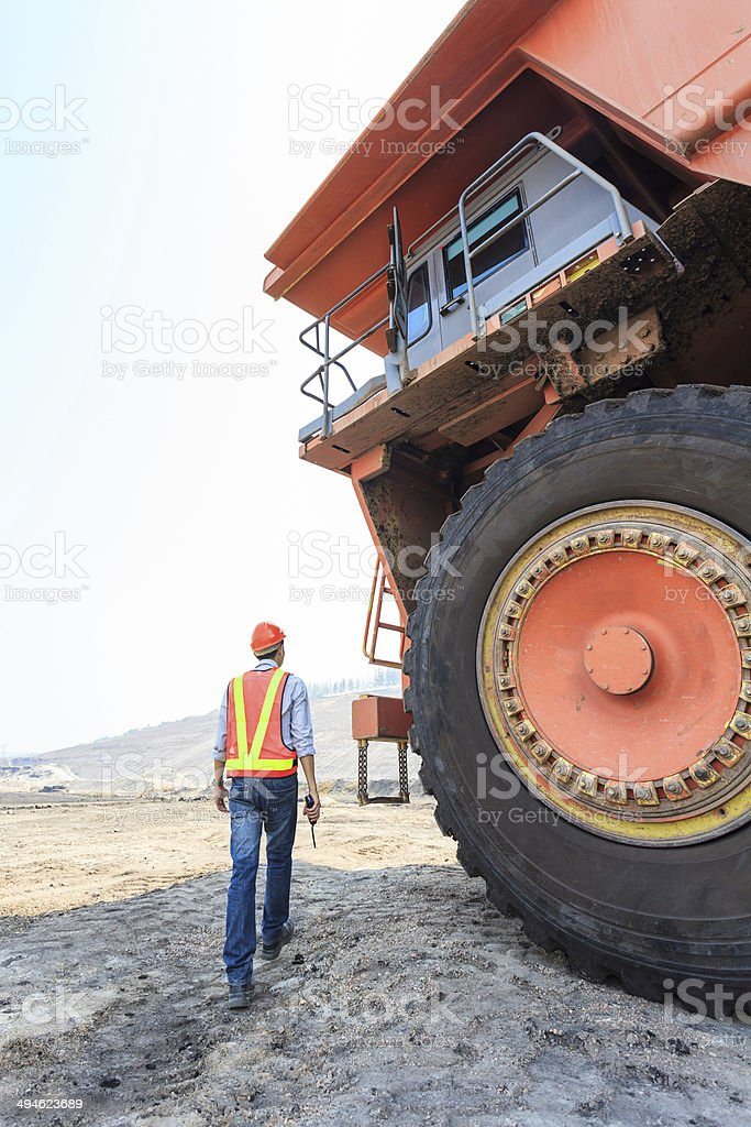 Worker Big Truck in Pit stock photo
