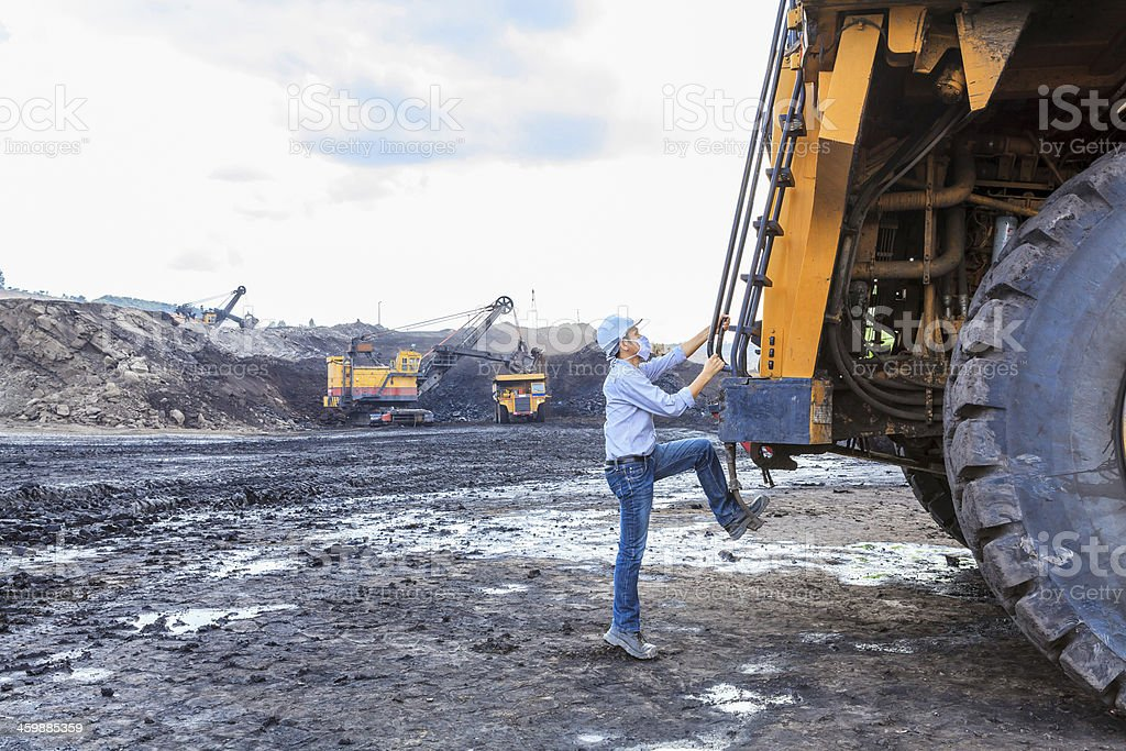Worker BigTruck in Open Pit stock photo