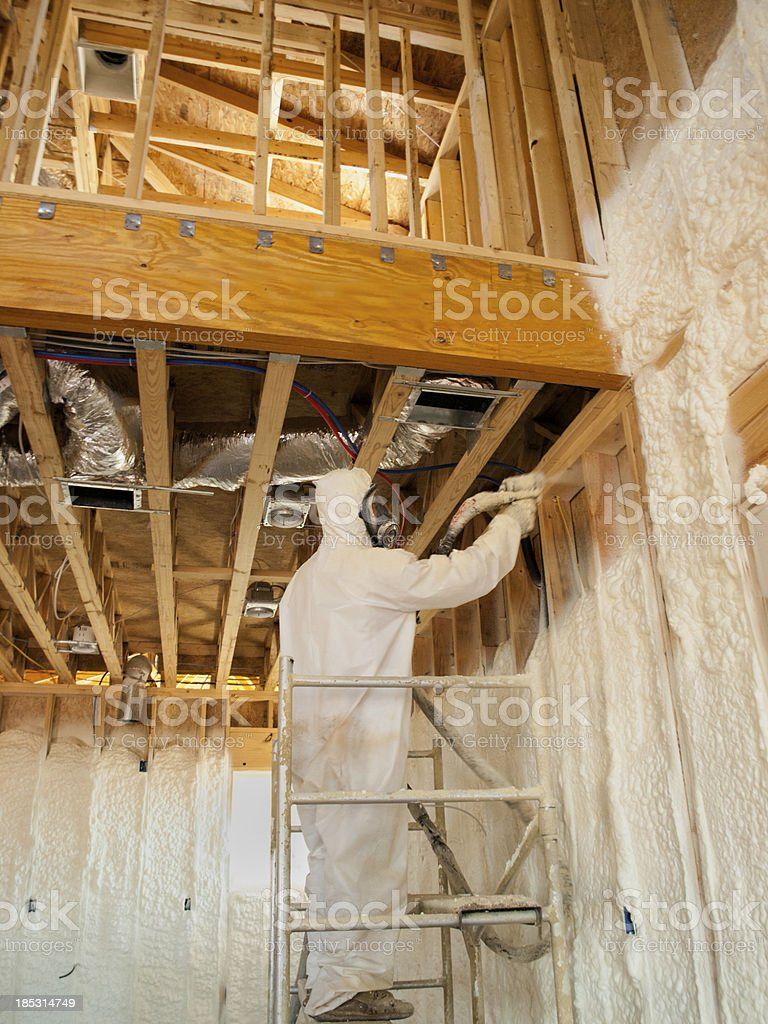 Worker Blowingr Polyurethane Foam stock photo