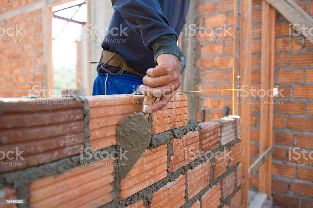 Worker building masonry house wal stock photo