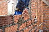 Worker building masonry house wal