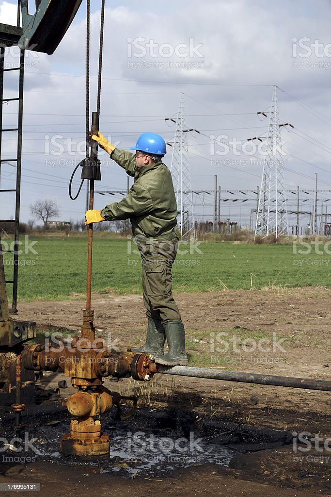 worker check oil pump royalty-free stock photo