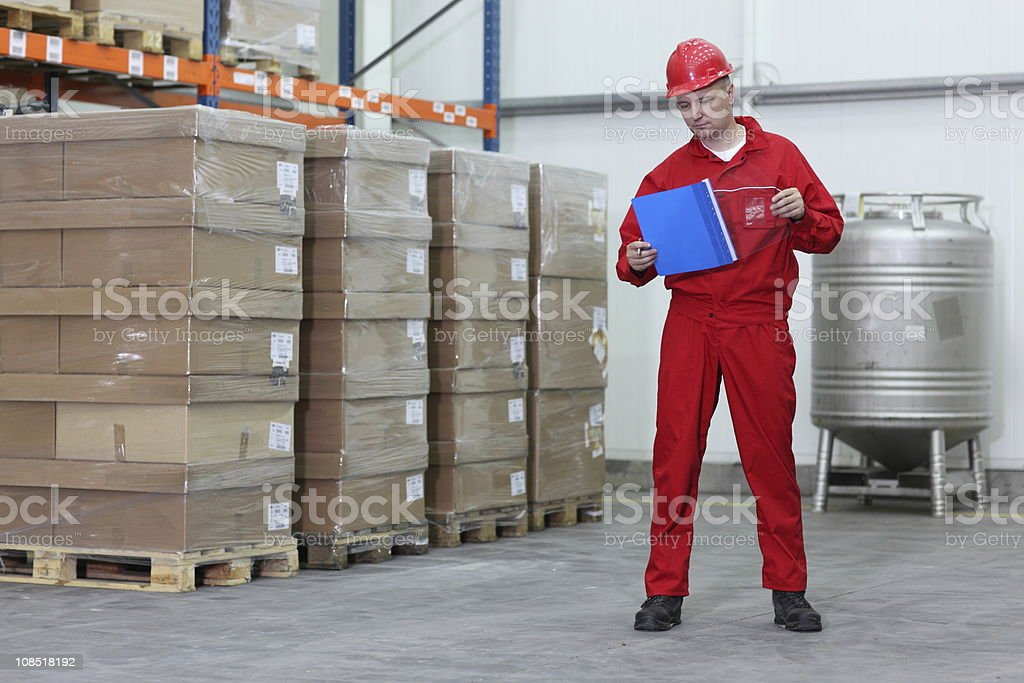 worker checking list of products royalty-free stock photo