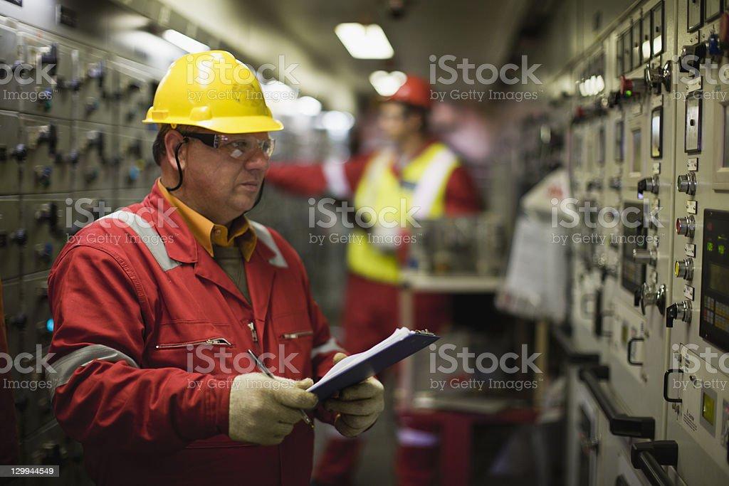 Worker checking machinery stock photo