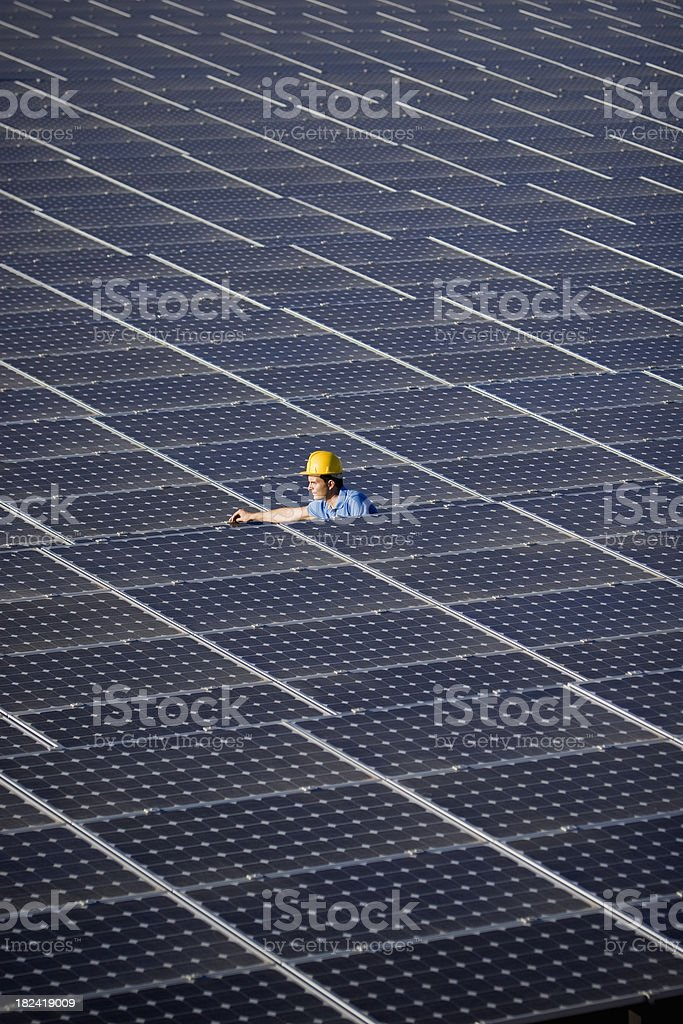Worker checking solar panels royalty-free stock photo