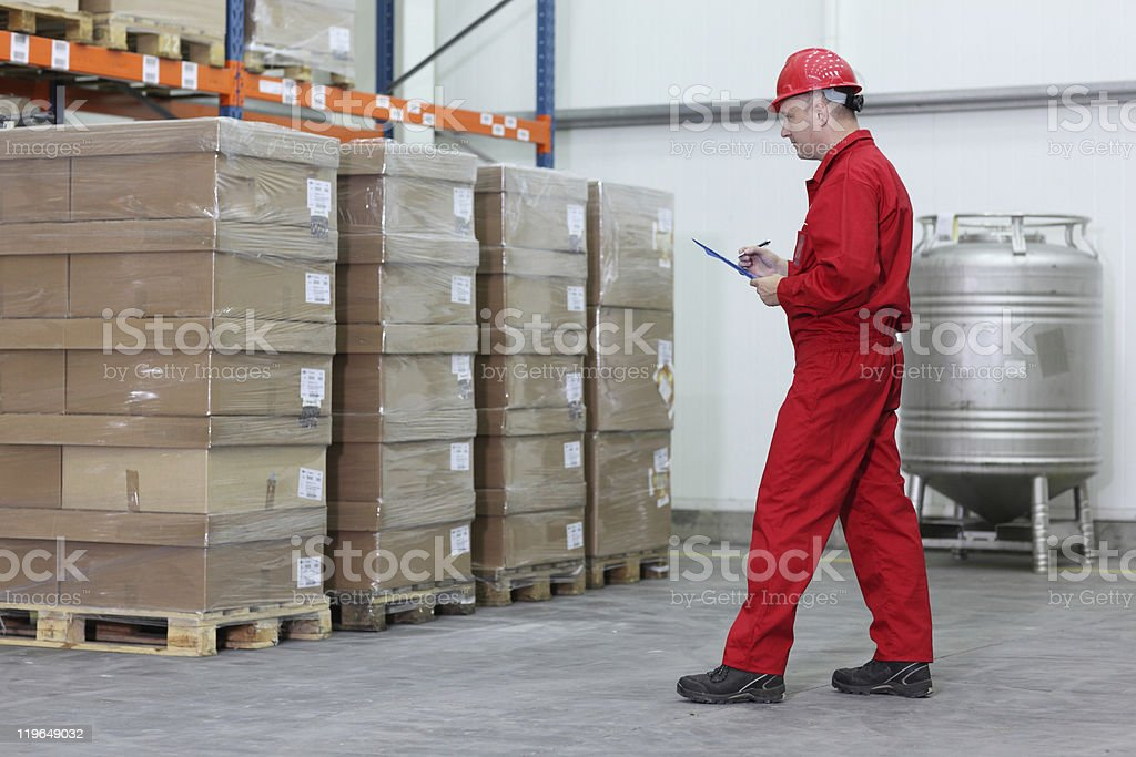 worker checking stocks in a company warehouse royalty-free stock photo