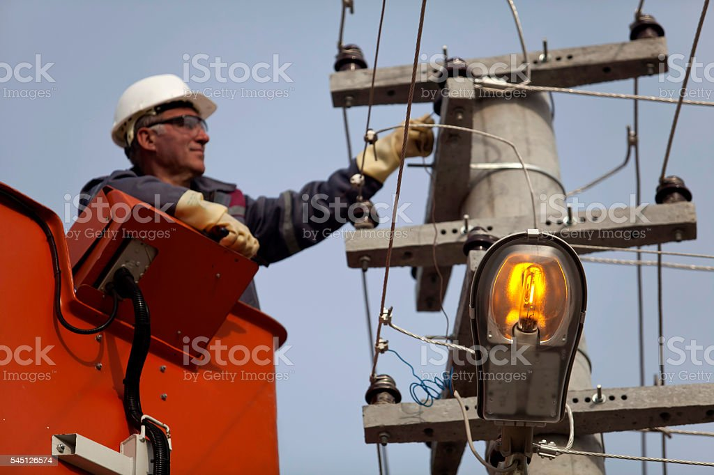 worker checking the electric line stock photo