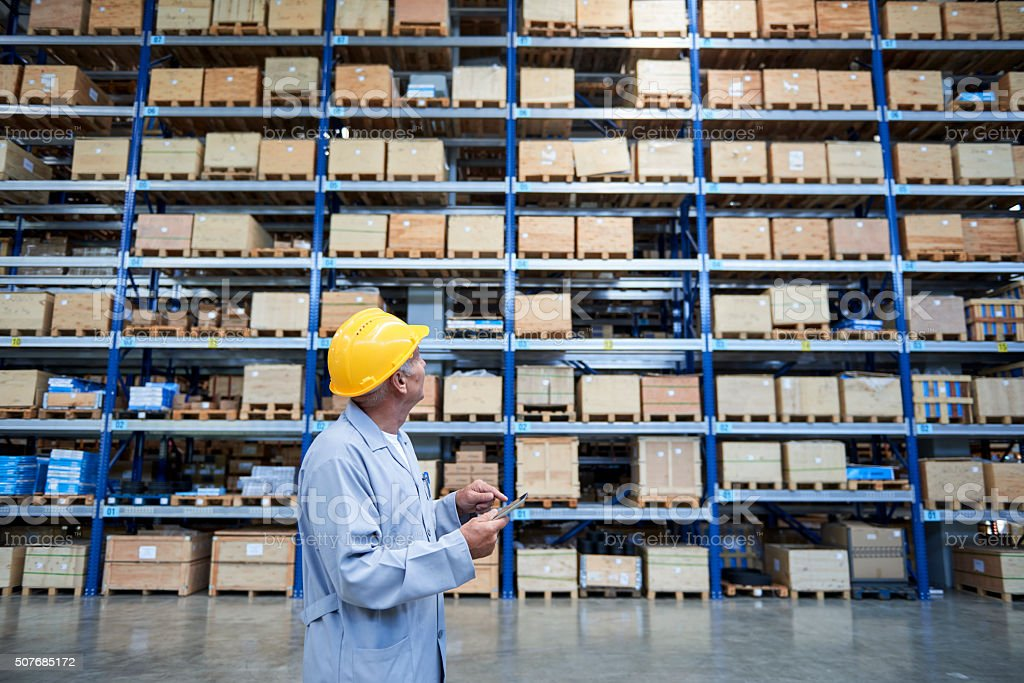 Worker checking the storages in warehouse stock photo