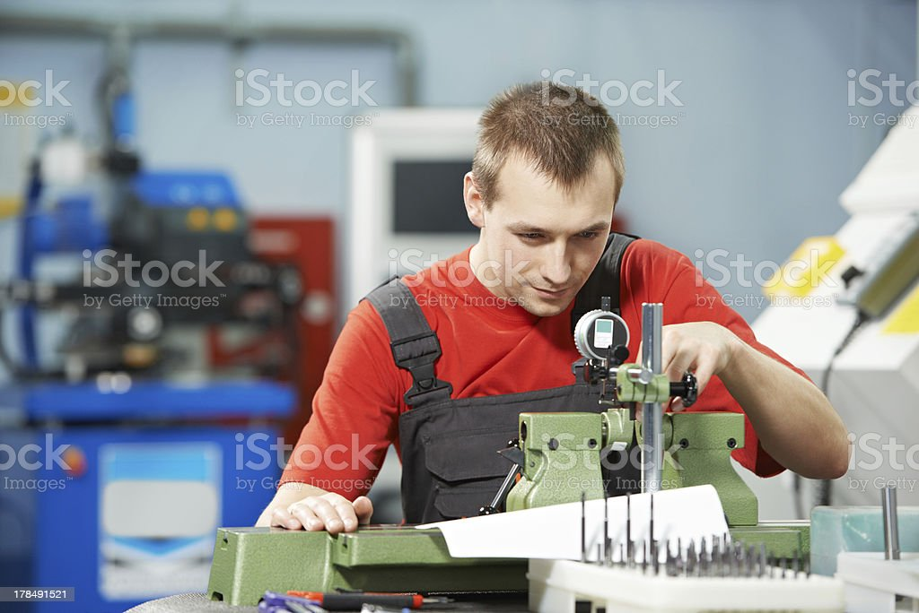 worker checking tool with optical device royalty-free stock photo