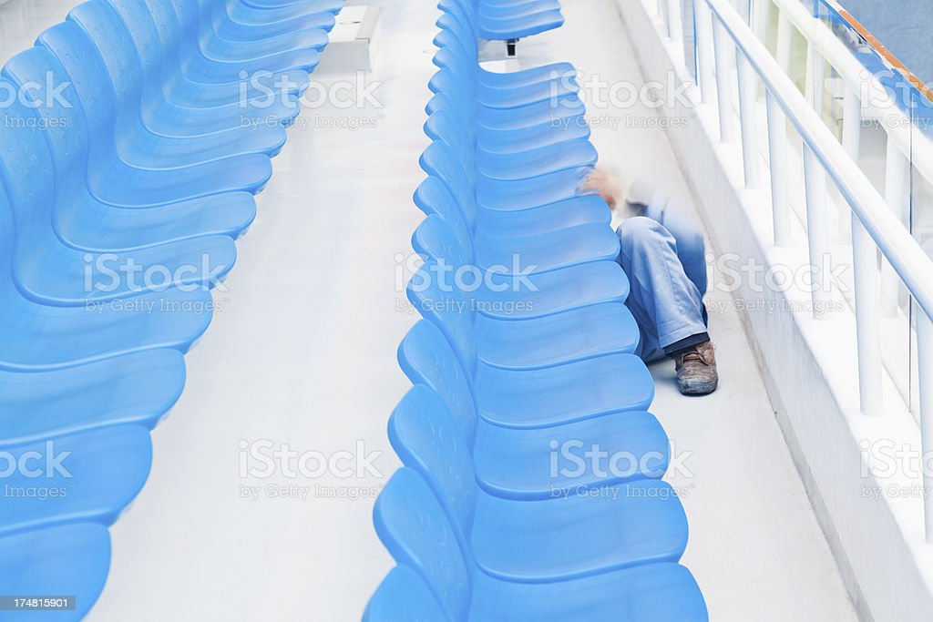 Worker clean stadium seats royalty-free stock photo
