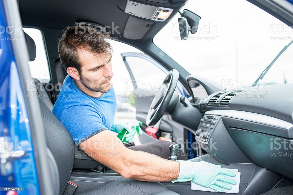 Worker cleaning car. stock photo
