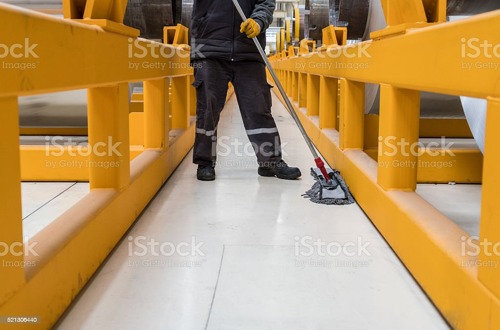 Worker cleaning floor stock photo
