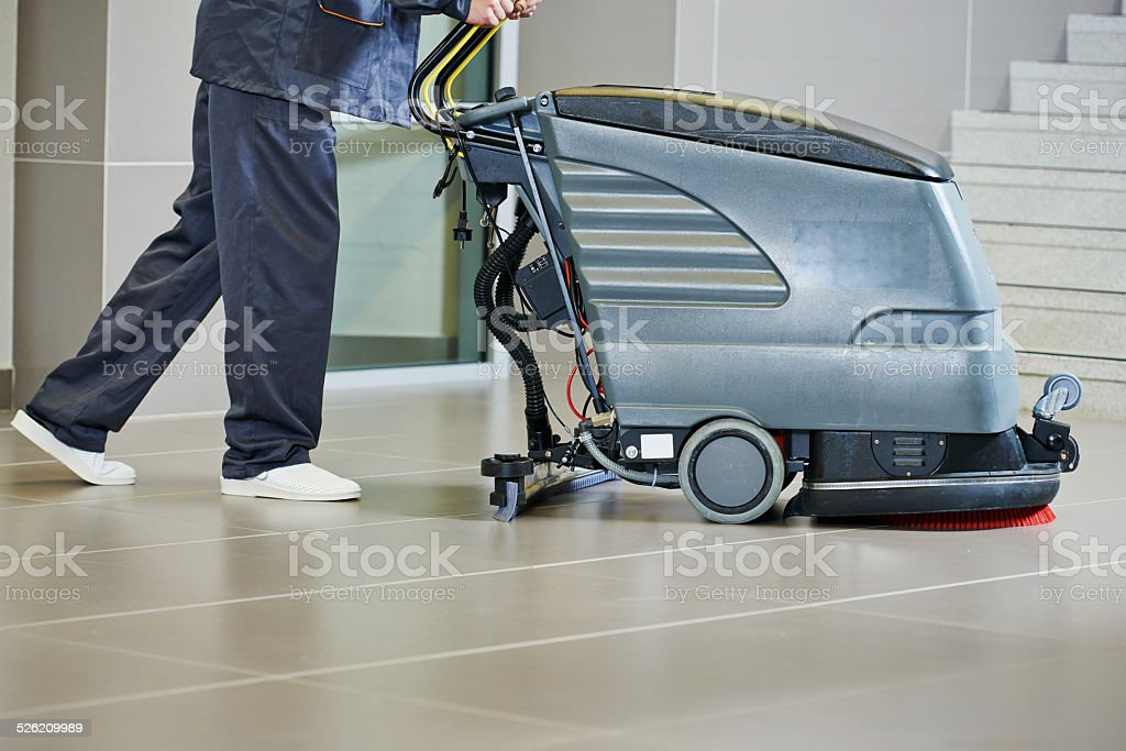 worker cleaning floor with machine stock photo