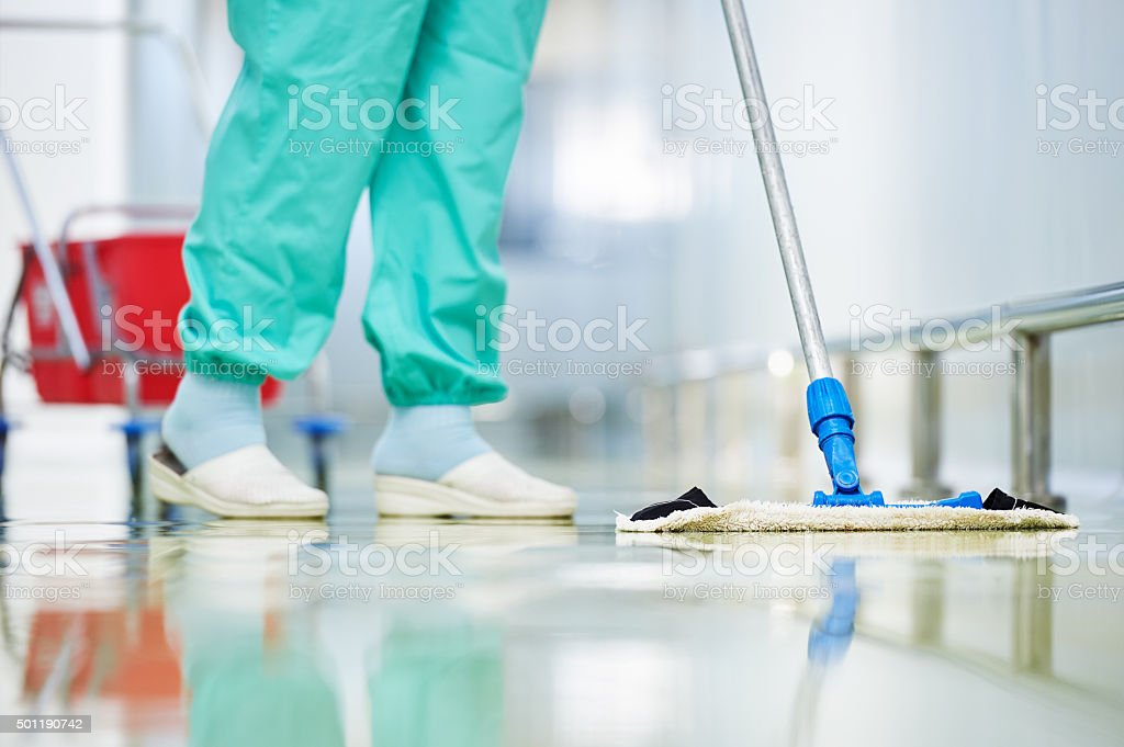 worker cleaning floor with mop stock photo