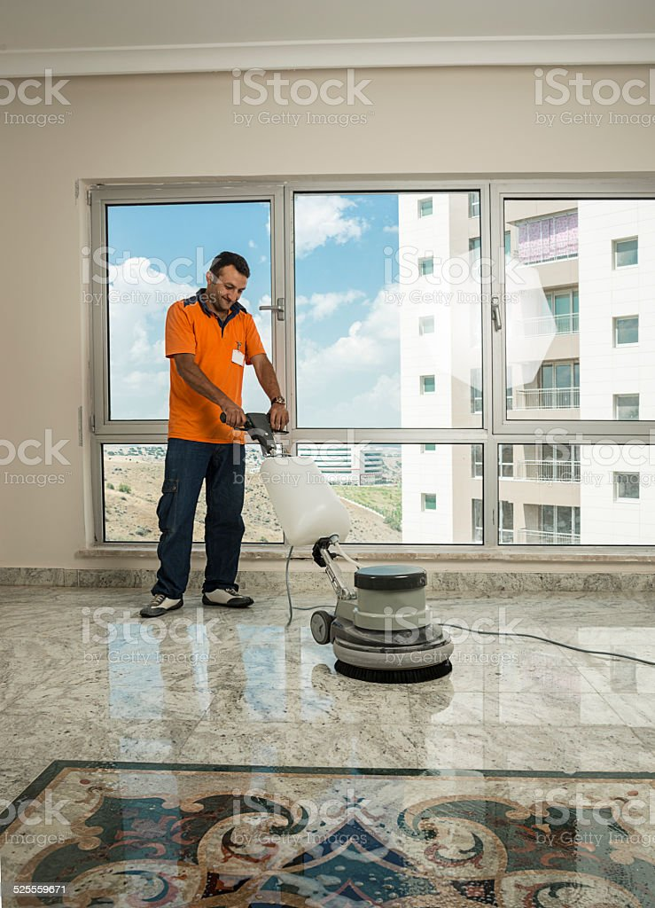 Worker Cleaning the Floor stock photo