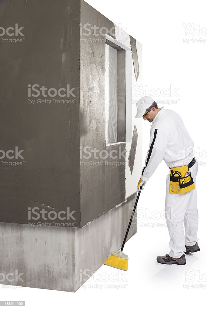 Worker cleaning with a broomstick royalty-free stock photo