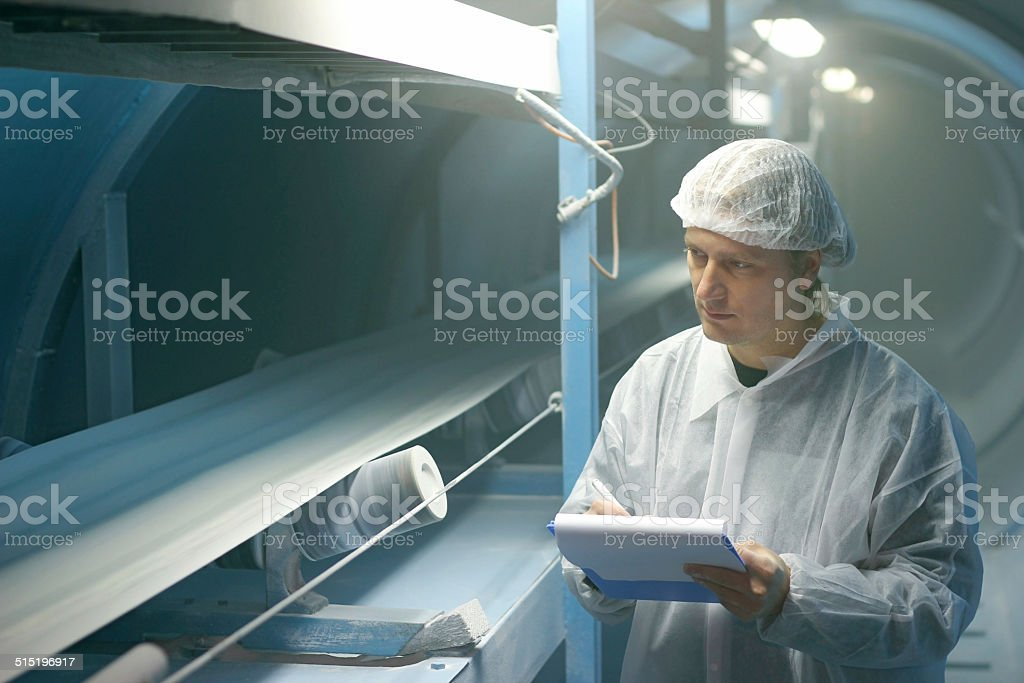 Worker controls the quality of sugar stock photo