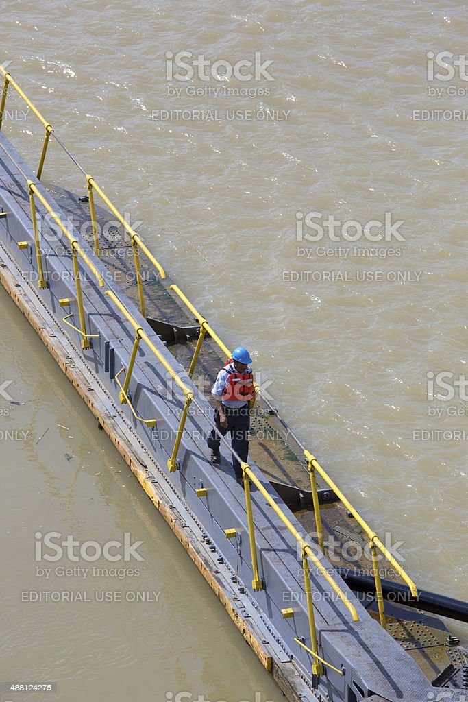 Worker crossing the canal of Panama at Miraflores stock photo