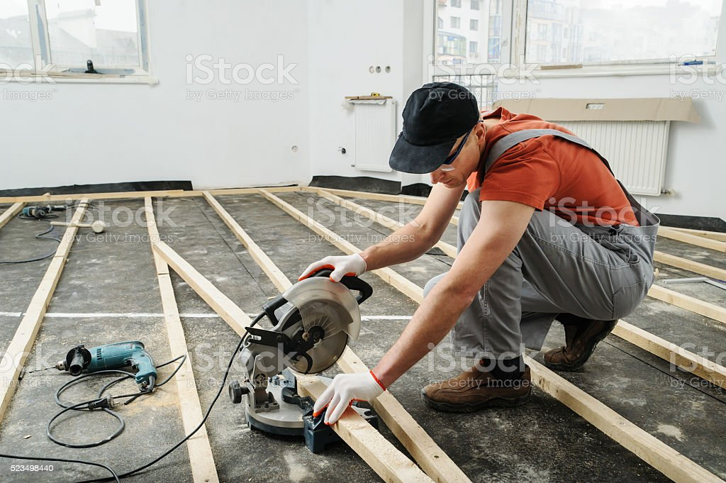 Worker cuts wood bars. stock photo
