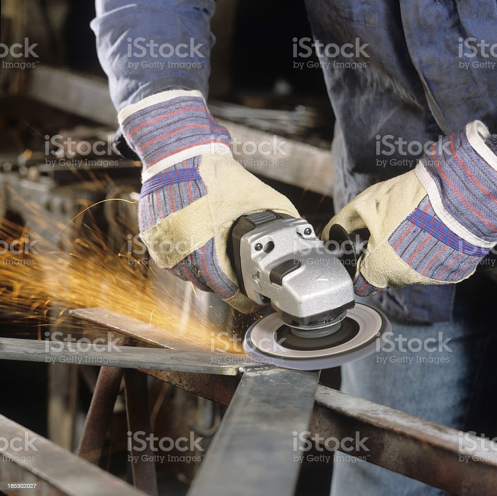 Worker cutting an iron part royalty-free stock photo