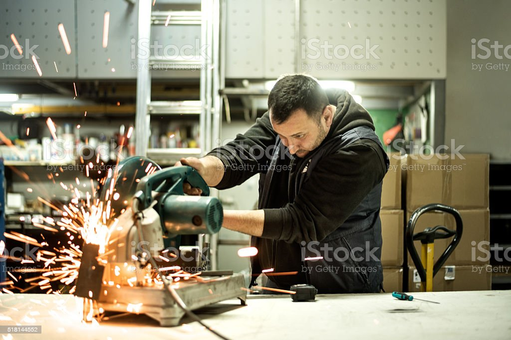 Worker cutting metal material stock photo