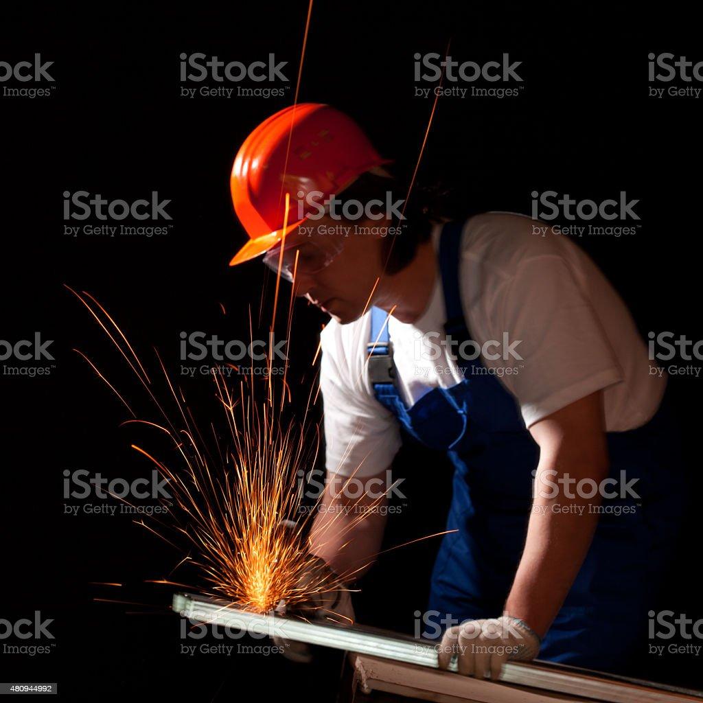 worker cutting metal stock photo