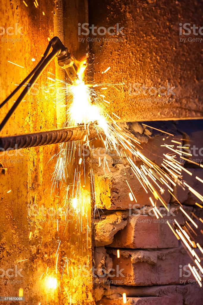 worker cutting steel board using metal torch. stock photo