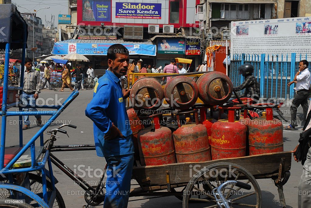 Worker deliverying LPG gas cylinders stock photo