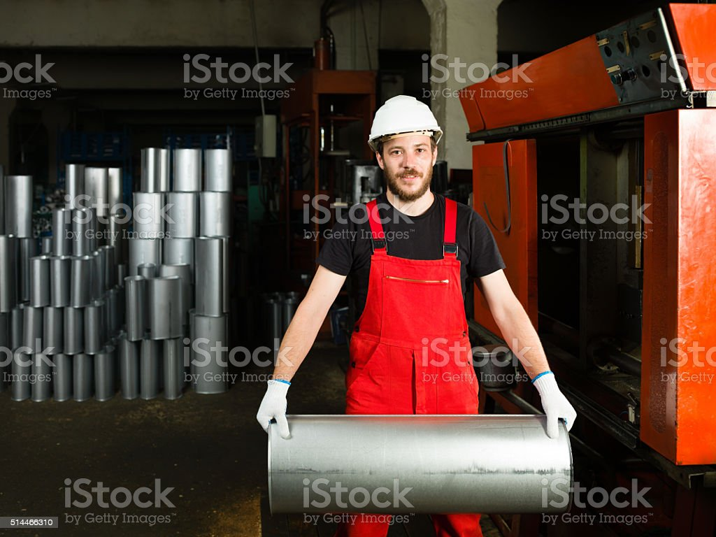 worker dressed in red overalls stock photo