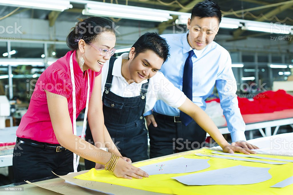 Worker, Dressmaker and CEO in a factory stock photo