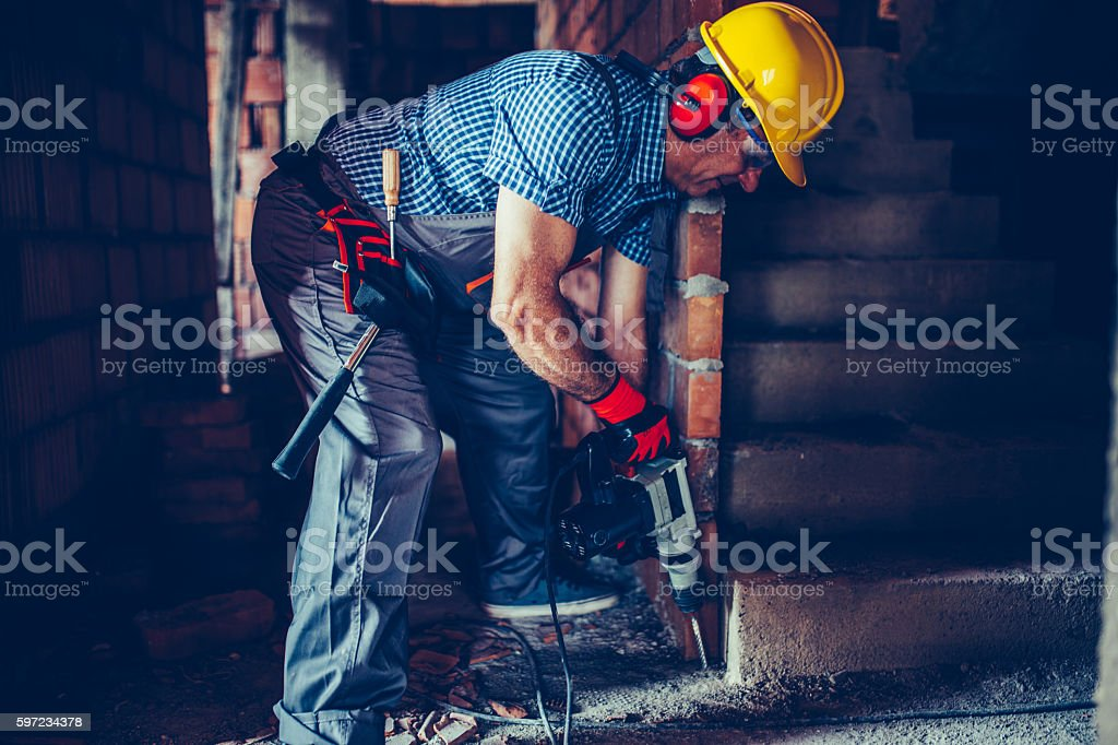 Worker drilling stock photo