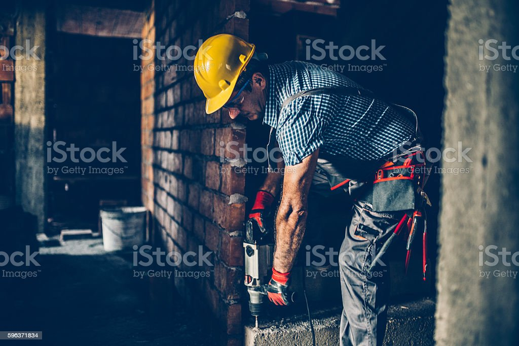 Worker drilling with a drill stock photo