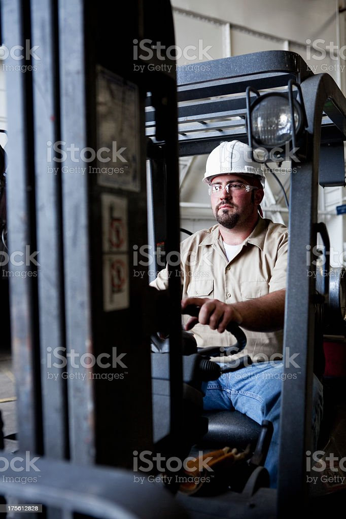 Worker driving forklift royalty-free stock photo
