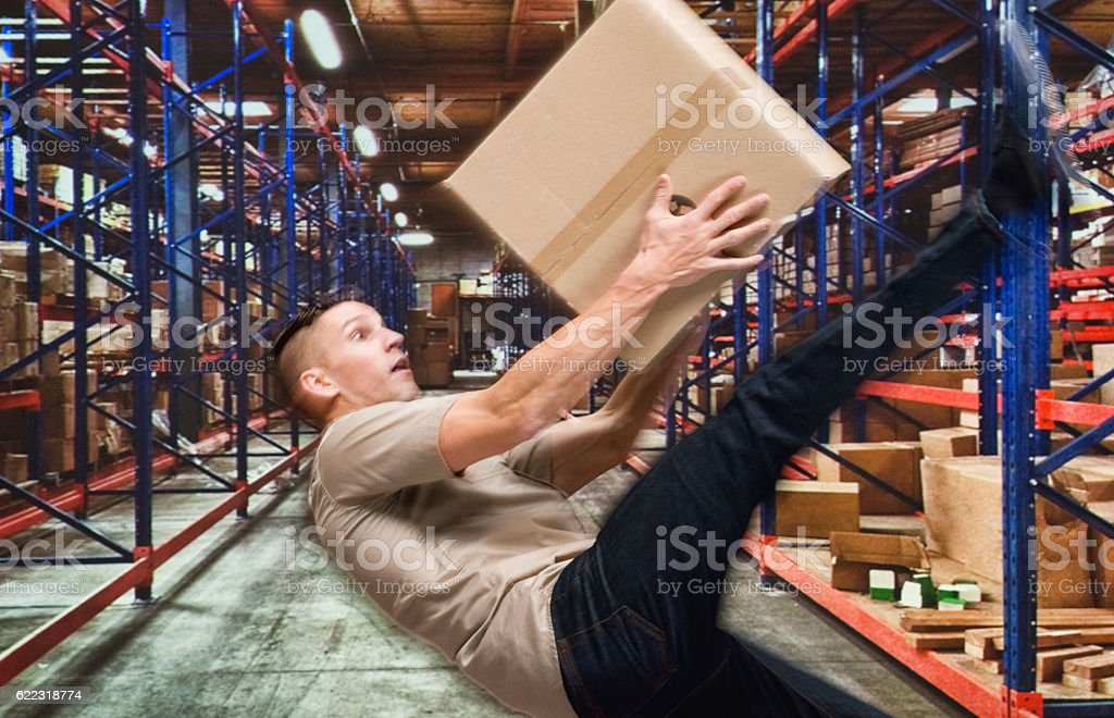 Worker falling in warehouse stock photo