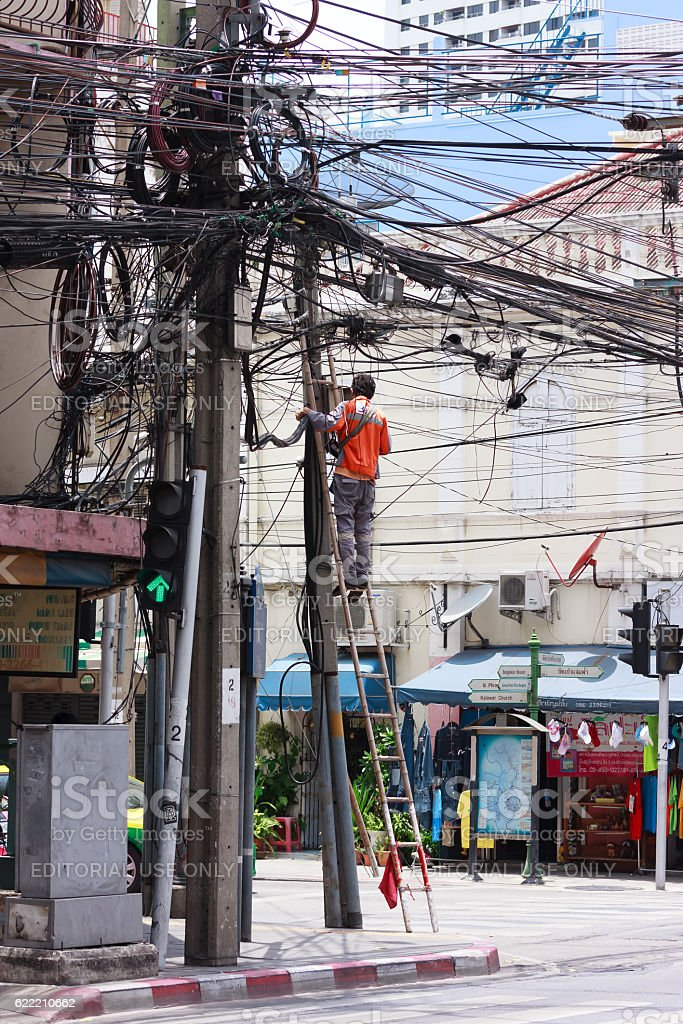 Worker fixing the internet network stock photo