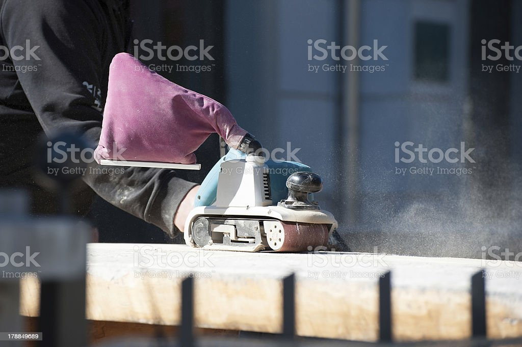 Worker furbish Furniture by electric sanding royalty-free stock photo