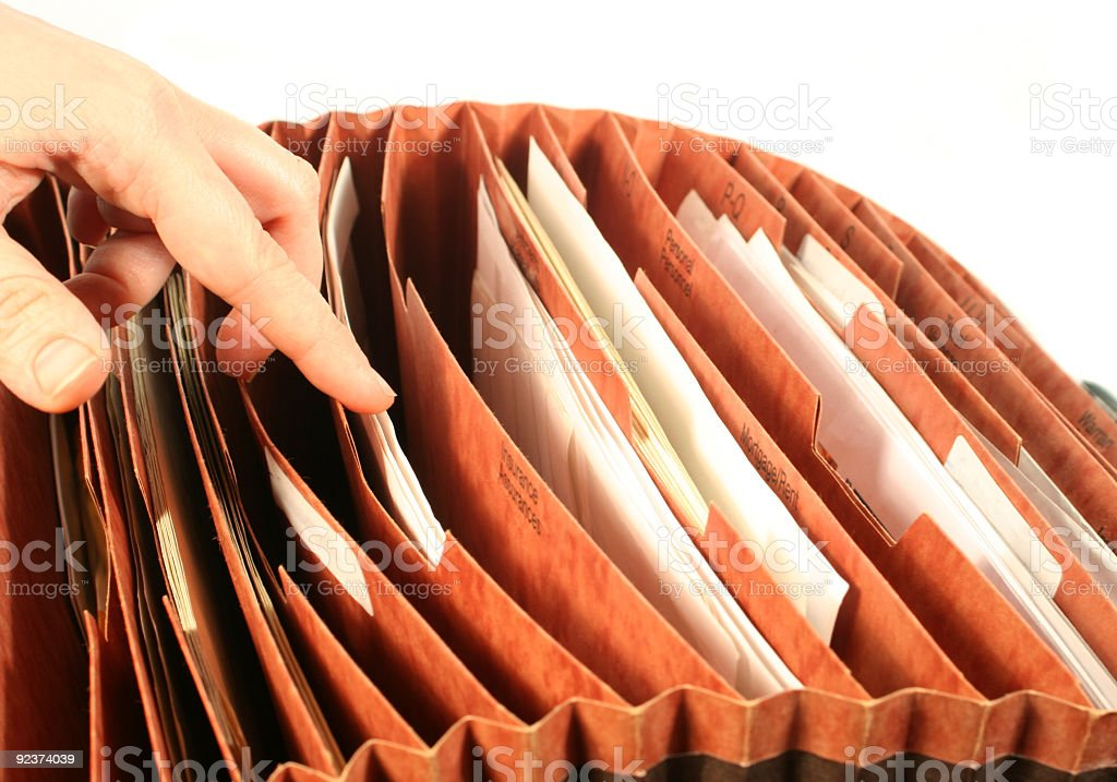 A worker going through a file folder royalty-free stock photo