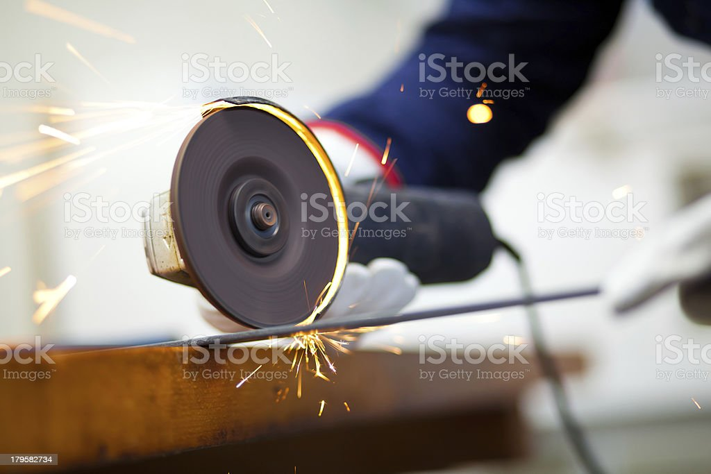 Worker grinding a metal plate royalty-free stock photo