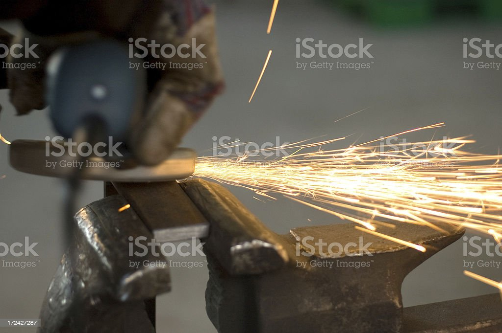 worker grinding, finishing metal, steel royalty-free stock photo
